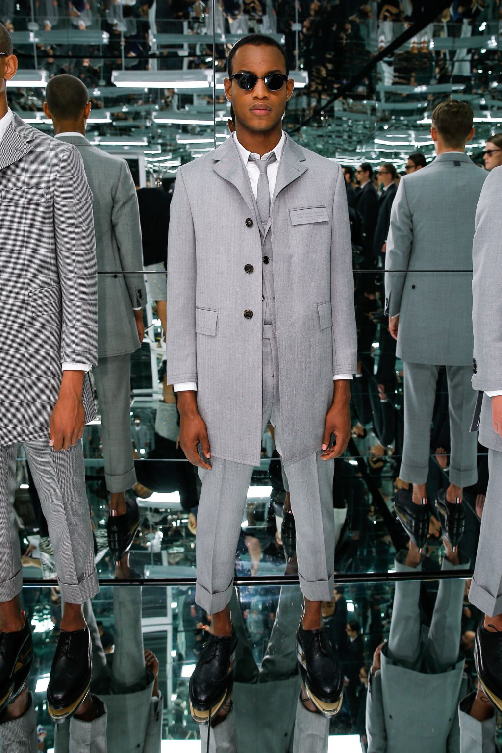 "NEW YORK, NY - JULY 14:  A model poses at the Thom Browne ""the officeman, 2015"" presentation during New York Fashion Week: Men's S/S 2016 on July 14, 2015 in New York City.  (Photo by Thomas Concordia/Getty Images)"