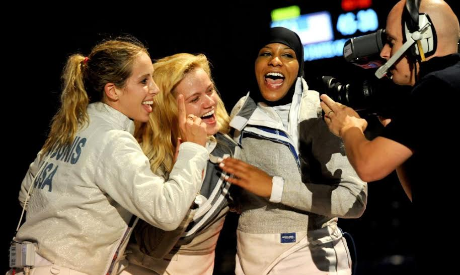 Mariel Zagunis, left, Dagmara Woznia, center, and Ibtihaj Muhammad, of the US, celebrate winning the bronze medal after defeating Italy in the womenís sabre team competition of the World Fencing Championship Budapest, Hungary, Monday, Aug. 12, 2013. (AP Photo/MTI, Imre Foldi)   ORG XMIT: MTI130 [Via MerlinFTP Drop]