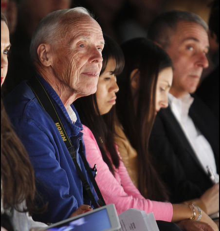 "Mr. Cunningham in the front row at the Naeem Khan show in September 2012 in New York. As Dean Baquet, The Times's executive editor, said about Mr. Cunningham, ""To see a Bill Cunningham street spread was to see all of New York."""