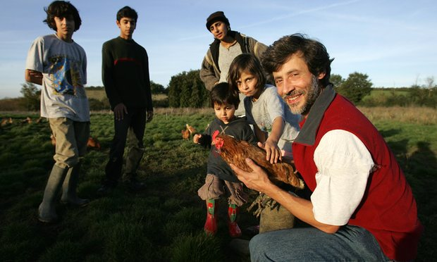 Lutfi Radwan with his family on his organic halal farm near Oxford. Photograph: Sam Frost for the Guardian